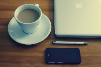 Coffee, iPhone and Laptop