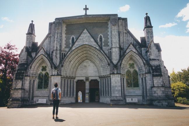 man-outside-church